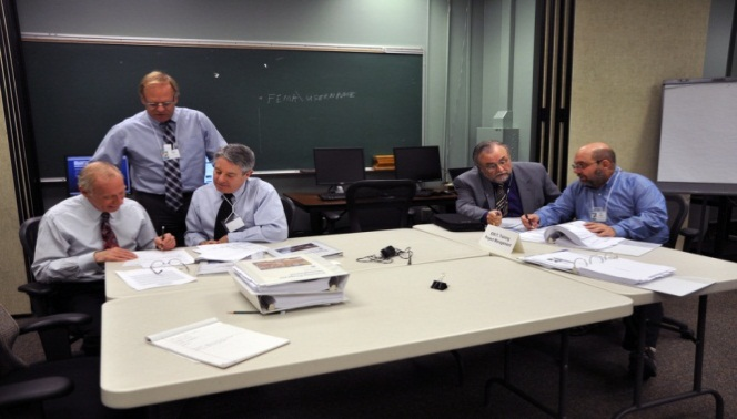Emmitsburg, Md., February 20, 2014 -- The National Coordinator and Reviewers from the American Council on Education examine EMI course materials during the February 20-21, 2014, site visit.