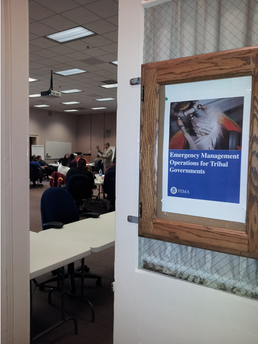 Door with Sign that says Emergency Management Operations for Tribal Governments opening to a classroom
